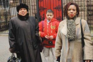 "Exiting historic St. Philips Church on to MacDonough Street, Sunday, January 25, entrepreneur and environmentalist Sherri Hobson-Greene(right sister and her son), a Bedford-Stuyvesant resident, was staggered by the news that two brownstones on the block may be demolished.  ""If there's something that can be done to save them, then it should be done – not just because they are brownstones, but because it is a signal to our children that working together, we can own and maintain where we live. This block is a jewel in New York City's crown.""   Photo credit:  Barry L. Mason"