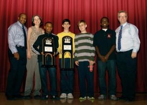 Winners all:  Principal Eric Windley,  Chess Teacher Elizabeth Spiegel James Black  Isaac Barayev,  Matthew Kluska,  Justus Williams and Chess Coordinator John Galvin.