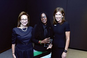 10K Winner: Library Manager Antonia Bramble (center) received a $10,000 award for the Bedford Stuyvesant branch from Charles H. Revson Foundation President Julie Sandorf (left), and Brooklyn Public Library President Linda Johnson at the foundation's NYC Neighborhood Library Awards. Photo Credit: Don Pollard.