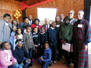Weeksville Historymakers and Journalists... Students, faculty and administrators from The Weeksville School/P.S. 243 joined Weeksville Heritage Center Board members, supporters, friends, community leaders and Brooklyn Borough President Markowitz at the recent groundbreaking for the complex to open this Spring.   The students, with the help of their teachers, also developed and wrote the article on this page describing the historic occasion.  The Weeksville students,  in the photo, are: kneeling on floor in pink- Jayla Shuler, 2-113; next to her with barrettes-Janae Singleton, 2-113; kneeling in blue looking up-Janiyah Hughes, 3-207. On left- girl in white shirt-Desiree Henderson, 2-113, girl facing away from camera-Ailec Lasalle, behind Ailec is Akirah Harris, 2-113, next to her is Chasity Patrick, 2-115, then Ranasia White, 2-115.  The boy is Maurice Williams-3-207. Back row, from left: Principal Karen Hambright-Glover; child is Amya Torres, 3-207; Teacher- Deborah Alexander (behind Amya);  Teacher- Jean Derico, and Weeksville founding Board member Dr. Marguerite Thompson, left of Mr. Markowitz Amongst the friends and supporters in this photo are: Timothy Simons, Board Chair, back row, left; Board member Eleanor Rollins, to the right of Mr. Markowitz; former Board member Pauline Barfield, standing next to Ms. Rollins; and, far right, Judith Burgess, also a former Board member.   (Photo credit: Bernice Elizabeth Green)