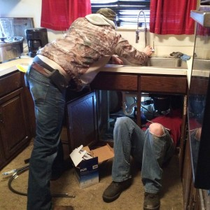 UA Plumbers install a faucet in the home of Loyce Driskell. Her old faucet wouldn't fit to the water filter. Photo: Tracy Samilton / Michigan Radio