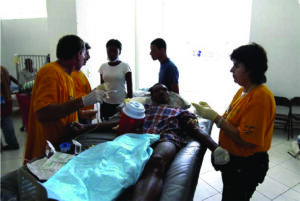Members of the Israeli Defense Force supply first-response care at a Haiti hospital.