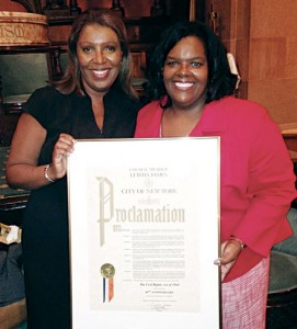 Leading Ladies: Letitia James (left) presents Obama appointee Jacqueline Berrien, chair of the Equal Employment Opportunity Commission, a City Council Proclamation at the Thurgood Marshall Forum. Photo credit:
