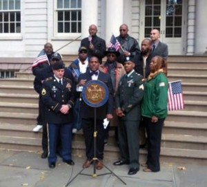 (L - R) - U.S. Army 42nd Infantry Division, Staten Island, Sgt. Jeffrey Parker; Senator Kevin Parker; U.S. Army 42nd Infantry Division, Staten Island, Sgt. Lesly Fontaine, Jr.; Mrs. Carrie Mobley, retired U.S. Army Sgt. First Class.  Directly behind Sen. Parker, black wide brim hat is Edward Daniels, Chairman, Incarcerated Veterans' Consortium; to his right, Brett Scudder, President, NY Humanitarians & Community Advocates Network