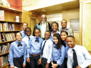 The 256 Student Council, along with, far right, Terry Henry, the parent coordinator, and school counselor Lenice Gray, greeted Vann upon his arrival in the school library which now is named after him.  Photo credit: Bernice Elizabeth Green