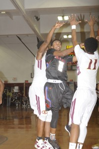 Thomas Jefferson's Shamorie Ponds makes an end-of-game shot, while pressed with a Christ-The King double-team.