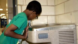 Pg2_african-a-boy-drink-fountain