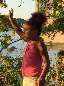 Jasanah, 7, waves to tugboats on the Hudson Photo: Bernice Green
