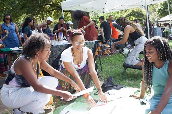 Planning for a bright future for Bedford Stuyvesant and Crown Heights are left to right, Leigh Taylor, food coop member, Ashleigh Eubanks, member leader, Raina Kennedy, food coop organizer. Photo courtesy CBFC